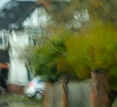 Street seen through rainy car window (Allan Rostron) Tags: northyorkshire yorkshire york suburbs rain windows