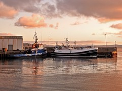 Greencastle, Co. Donegal. (willieguildea) Tags: greencastle donegal eire ireland ulster harbour port quay boats fishingboats trawlers sky clouds coast coastal nikon coolpix p900 evening dusk water waterscape
