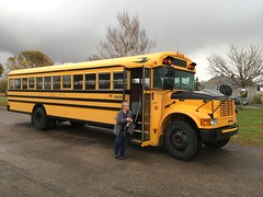 School Bus of venerable vintage with Susan at the wheel. (Paul F Barton) Tags: buses susan