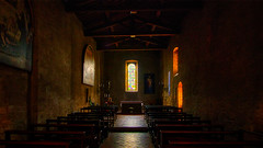 A small chapel in San Gimignano - Toscana (norbert.wegner) Tags: church religion christianity indoors spirituality old architecture catholicism chapel dark nopeople history pew cathedral cross praying cultures colorimage architectureandbuildings insideof