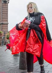 Red Rain Poncho (Emil de Jong - Kijklens) Tags: woman vrouw girl meisje roodred regen regenkleding raincoat tourist toerist amstertdam wapen donut donuts rain kijklens kijkenmetkijklens