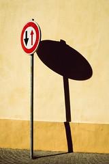 The shadow of yield (dono heneman) Tags: cédezlepassage yield panneaudesignalisation panneau trafficsign cédez givein passage minimaliste minimalisme minimalism urbain urban urbaine village town rue street mur wall ombre pavés pavement rond ring sérignan hérault languedocroussillon occitanie france pentax pentaxart pentaxk3