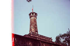 Hanoi Flagtower (hiphopmilk) Tags: copyright©jaredyehwooehmoehfilms film analog analogue 35mm 135film kodakfilm kodak jaredyeh hiphopmilk nikonfm2 nikonfm2n nikon nikkor vietnam hanoi travel streetphotography filmburn flare tower flag flagtower cột cờ hà nội