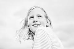 That smile, that happiness (B&W edit) (PascallacsaP) Tags: smile happiness smiling portrait portraiture film simulation filmsimulation availablelight outdoorportrait venlo hair wind freckles sky bw blackandwhite blackwhite agfaapx25 monochrome captureonepro highkey