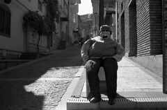 Stop, Pay Toll  (Fuji Acros 100) (Harald Philipp) Tags: urban citycenter downtown cobblestone dummy sidewalk pavement city street funny d76 holiday vacation tourism exotic destination travel adventure wanderlust haraldphilipp blackandwhite bw blackwhite monochrome schwarzweiss nocolor nophotoshop fujifilm acros iso100 35mm 135 film grain analog filmphotography nikon nikkor fm3a slr classiccamera antiquecamera 5000ed coolscan europe european georgia tblisi selfdevelop homedeveloped