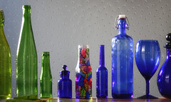 This mornings glow (Snorkle-suz) Tags: smileonsaturday letitglow glass bottles blue green stainedglass translucent dimpledglasswindow indoors newzealand insidemyhouse inside indoor light window windowsill nz aotearoa stilllife series transparent beautiful display sill glassseries canoneos600d canoneosrebelt3i canoneoskissx5 50mm ef50mmf18stm