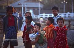 Sittwe, kids (blauepics) Tags: myanmar birma burma southeast asia südostasien 1996 sittwe rakhine state province provinz burmese birmane little young jung kleines girl mädchen cute goldig süs kids kinder children face gesicht smile lachen evening light abendlicht happy glücklich licht red rot sweet portrait porträt