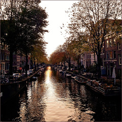 It is really a crisis when we have to add more water to the wine. (~Ingeborg~) Tags: meinge amsterdam egelantiersgracht prinsengracht water boats darkness sinkingsun reflections withdiana suninthewater thesunlightinthewater sununderthebridge autumn terrace canal phone mp