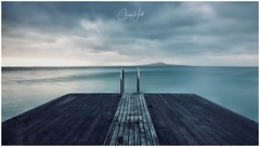Solitude (cjhall.nz) Tags: moody dramatic cinematic tokina1120 t4i 650d canon framedinnz wideangle longexposure horizon seascape landscape overcast cloudy firstlight daybreak dawn morning harbour ocean beach sea seat bench ladder swimming diving platform pier jetty wharf newzealand auckland northshore murray'sbay