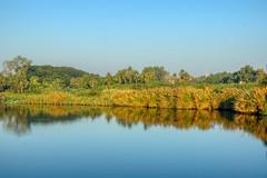 Morning on the river Kwae Yai in Kanchanaburi, Thailand (UweBKK (α 77 on )) Tags: kanchanaburi province thailand southeast asia sony alpha 550 dslr river stream kwae kwai riverkwai water flow reflection nature outdoors scene scenic scenery landscape landschaft yai kwaeyai