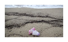 lost (giovdim) Tags: toy sand beach greece lost find depression found waves bythesea autumn loneliness