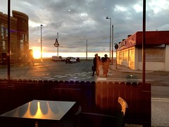 Machlud / Sunset - C Fresh Fish & Chips, Foxhall (Rhisiart Hincks) Tags: cysgodion scáthanna shadows light sklêrijenn solas goleuni bywydystryd streetlife kafetegi kafedi caife café caffi caffe glanymôr seaside sunset machlud sirgaerhirfryn lancashire blackpool iascissceallóga stalfritez chipshop fishandchips siopsglodion dreurprenestr trífhuinneog throughawindow drwyffenestr