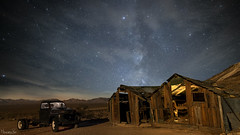 Rhyolite at Night (magnetic_red) Tags: truck old decay abandoned buildings wood wooden shacks night sky milkyway mountains desert rhyolite nevada ghosttown americanwest