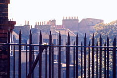 """A Hotel """"Welcome"""" (AntyDiluvian) Tags: england greatbritain britain london vintage 1973 hotel londonparkhotel elephantandcastle window spikes paling fence"""