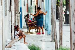 Girl and Women on Porch, Cienfuegos Cuba (AdamCohn) Tags: adam cohn cienfuegos cuba cubana girl streetphotographer streetphotography wwwadamcohncom adamcohn