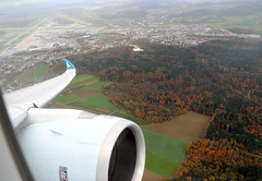 fall colors in Switzerland (Jaws300) Tags: canon5d cathaypacific cathaypacificairways flyingscenery fromabove cathay pacific airways airbus a350 a351 a3501000 blxa departing departure takeoff cx cpa bank plane banking turn turning fall colors colours trees tree woods forest canon changingcolours changing brown red village town 5d airport runway runways taxiway taxiways flying scenery zurich above airborne aloft kloten zrh lszh zürich flughafen flughafenzürich zürichflughafen swiss switzerland airlines 28300mm ef28300 ef28300mm stand parking terminal apron ramp airline air zurichkloten climbout rollsroyce
