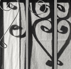 Papered window (queue_queue) Tags: closed window bars gate abandoned hearts shadows