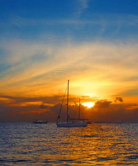 Sailboat Sunset (oceanzam) Tags: sun sunset sea ocean seashore shoreline landscape panorama color colorful colour light dark bright shadow boat sailboat barco travel nature outdoors outside clouds tropical serene blue orange azul mexico water reflection dusk sky beauty tranquil