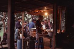 In a Rural Tea Stall... (Sheikh Shahriar Ahmed) Tags: ruralbangladesh nikon travelphotography fujicolorc200 film teastall bangladesh dusk incandescent delduar store candid travel tea tangail tungsten af50mmf18d istillshootfilm analogphotography pacificimageprimefilm3650pro3 nikonf100 fujifilm