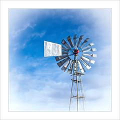 Head In The Clouds (Daniela 59) Tags: sliderssunday hss topazstudio2 windpump clouds blue danielaruppel