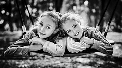 Portrait on a swing (Unicorn.mod) Tags: 2019 monochrome blackandwhite blackwhite bw bokeh girl girls swings summer shadows light child childs smile joy canon canoneosr canonef50mmf12lusm autofocus autumn september