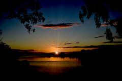 Supernova (Dreaming of the Sea) Tags: sliderssunday manipulation sunset bluesky bundaberg burnettriver queensland tamronsp2470mmf28divcusd nikond7200 australia clouds water gumtrees gimp reflections sun hss sunsetoverwater