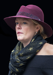 Portrait (D80_546972) (Itzick) Tags: candid copenhagen color colorportrait blackbackground woman hat face facialexpression streetphotography scarf earrings portrait denmark d800 itzick