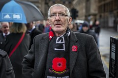 Remembrance (Leanne Boulton) Tags: urban street candid portrait portraiture streetphotography candidstreetphotography candidportrait streetportrait eyecontact candideyecontact streetlife old man male face eyes expression emotion mood feeling glasses remembrance remembrancesunday poppy poppyday armisticeday reportage tone texture detail depthoffield bokeh naturallight outdoor light shade city scene human life living humanity society culture lifestyle people canon canon5dmkiii 70mm ef2470mmf28liiusm colour glasgow scotland uk
