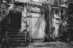 (a.pierre4840) Tags: olympus om4ti tamron sp adaptall 17mm f35 35mmfilm rollei rolleirpx400 bw blackandwhite noiretblanc alley alleyway urban decay shadows kowloon hongkong