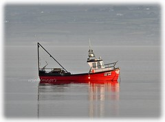 Red boat on the river, Lough Foyle, Co. Donegal. (willieguildea) Tags: river lough loughfoyle donegal ireland eire ulster water waterscape coastcoastal coastalireland boat vessel fishingboat nikon coolpix p900 seascape mooring