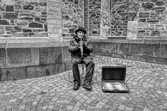 A LONELY STREET MUSICIAN (NorbertPeter) Tags: man street people spontaneous city urban portrait music hilden germany hat instrument streetphotography streetportrait streetmusician musician old monochrome sony ilce7 blackandwhite bw