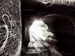 Every town has dark corners.... (mark.griffin52) Tags: england hertfordshire berkhamsted grandunioncanal contrast shadow darkness sunshine sunlight sun urban blackandwhite water canal wall tag graffiti brick arch bridge
