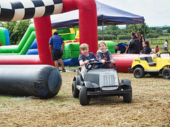 Little drivers bouncy castle (Julie V. Simpson Photographer) Tags: green trees leaves nature shadows naturalworld instadaily instagram instanature naturephotography naturelovers natureza natureperfection newzealand waimatenorth apshow roses horses tractor