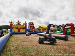Bouncy castles and cars (Julie V. Simpson Photographer) Tags: green trees leaves nature shadows naturalworld instadaily instagram instanature naturephotography naturelovers natureza natureperfection newzealand waimatenorth apshow roses horses tractor