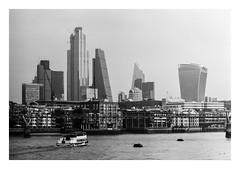 FILM - City skyline (fishyfish_arcade) Tags: 35mm 800asa acros analogphotography bw blackwhite blackandwhite filmphotography filmisnotdead fujifilm istillshootfilm london monochrome olympusom1 zuiko28mmf35 analogcamera film mono pushed cityoflondon skyscraper architecture riverthames boat