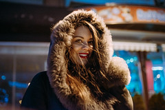Portrait of a Smiling and beautiful girl outdoors (shixart1985) Tags: beautiful beauty building cap caucasian city closeup cold cute evening female girl glamour hair happiness happy jacket joy lights looking night outdoors outside people person portrait prety smile smiling standing street sweater urban winterdecember woman young youth