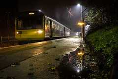 Celebrating Pacer Travel (Andrew Shenton) Tags: yellow 142026 pacer leeds goole woodlesford fireworks november damp night dark railway train 2f25