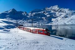 Lago Bianco: red in a lot of blue and white (1/3) (jaeschol) Tags: 3503 abe812 allegra berninapass eisenbahn europa europe graubuenden grischuna kantongraubünden kontinent rhb schweiz stadler suisse switzerland transport triebzug chemindefer railroad railway