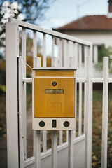 A yellow mailbox with the iron grill door. (shixart1985) Tags: adress antique architecture autumn box building classic closed communication day delivery design door exterior gate grilled grunge home house iron letter locker mail mailbox messages messenger nobody open outdoors post safety vintage white