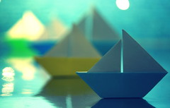 The Regatta (Ronnie Gaye) Tags: boats regatta origami paper sailing water macro blue yellow green tabletop creative