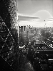 Looking East in the City (35mmMan) Tags: gherkin monochrome city london square mile high rise huaweimobile grainy blackwhite canary wharf cityscape