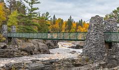 Bridge Over Rocky Waters (Greg Riekens) Tags: autumn usa landscape bridge nikond500 midwest fall rocks trees jaycookestatepark river scenic stlouisriver fallcolors swingingbridge fallleaves statepark minnesota