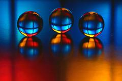 triplicated colour reflection (HansHolt) Tags: glass colors colours clear marbles multicolor knikkers triplicated macro reflection canon colorful dof bokeh kleurrijk 6d kleuren veelkleurig canonef100mmf28macrousm canoneos6d hmm macromondays 3 three blue red yellow mondrian mondriaan destijl pietmondrian