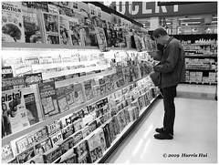 We Read The World - PriceSmart X5474e (Harris Hui (in search of light)) Tags: harrishui fujix10 digitalmirrorlesscamera fuji fujifilm vancouver richmond bc canada vancouverdslrshooter mirrorless fujixambassador x10 fujixcompactcamera fujixseries fujix reader reading bw street streetphotography candid blackwhite digitalbw magazine supermarket monochrome immersed