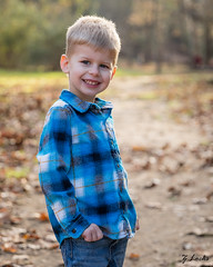 The One Where He Smiled (zachary.locks) Tags: 52frames boy day depth dirt fall field happy jack leaves light park portrait rim road smile son toddler warm zlocks blurred shallow background bokeh small aperture flannel