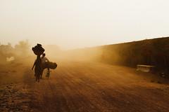 Dusty Road, Chhatarpur, Madhya Pradesh India (AdamCohn) Tags: adamcohn chhatarpur india madhyapradesh carryingonhead dust dusty silhouette streetphotographer streetphotography wwwadamcohncom