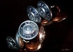 British Buttons......REFLECTION.....Macro Mondays ! (Lani Elliott) Tags: macro upclose closeup bokeh reflections blackbackground vintage buttons britishrailwaybuttons shiny glistening glowing yesteryear lanielliott stilllife reflection macromondays