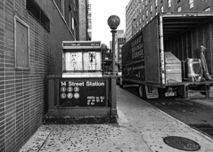 12th St. & 7th Ave. (Emmanuel Z. Karabetis) Tags: 24105mm f40 canon 5d markii nyc new york manhattan black white bw moving truck payphone pay phone verizon 14th st street station metro subway train greenwich village