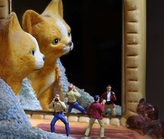 Macro Monday - Reflections.   The photographers were very excited to find the legendary large cat, though unfortunately one of them preferred to take a selfie.   Silly Billy!  IMG_0573 (alisonhalliday) Tags: macromondays reflection ornament cat mirror photographers littlepeople miniaturefigures modelphotographers macro closeup canoneosrp sigma105mm