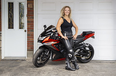 Proud motocyclist (paulmccuytney) Tags: girl bike biker beautiful single person female young smiling adult model outdoor cute caucasian transport vehicle blond black leather pretty woman clothes sexy attractive wheels posing driver motorbike motorcycle motor dressed rider jacket chopper motorcyclist